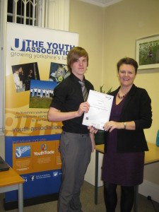 Paul receiving his OCN certificate from local business owner Catherine Yaffe