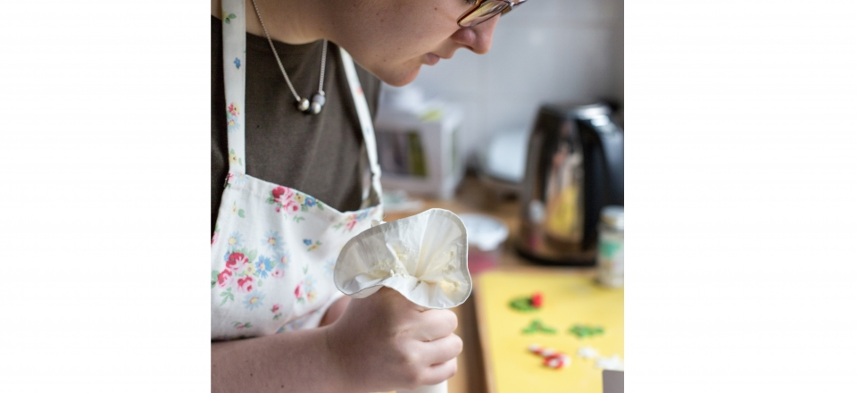 13. Olivia Williams who makes and sells cupcakes puts the finishing touches to a batch-edit